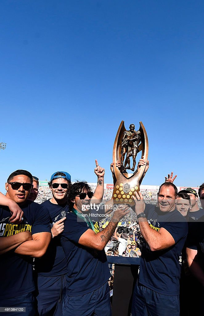 The Cowboys team hold aloft the NRL trophy on stage during the North Queensland Cowboys NRL Grand Final fan day at 1300 Smiles Stadium on October 5, 2015 in Townsville, Australia.