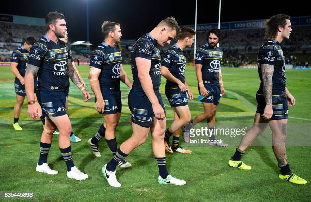 The Cowboys walk from the field after losing the round 24 NRL match between the North Queensland Cowboys and the Cronulla Sharks at 1300SMILES...