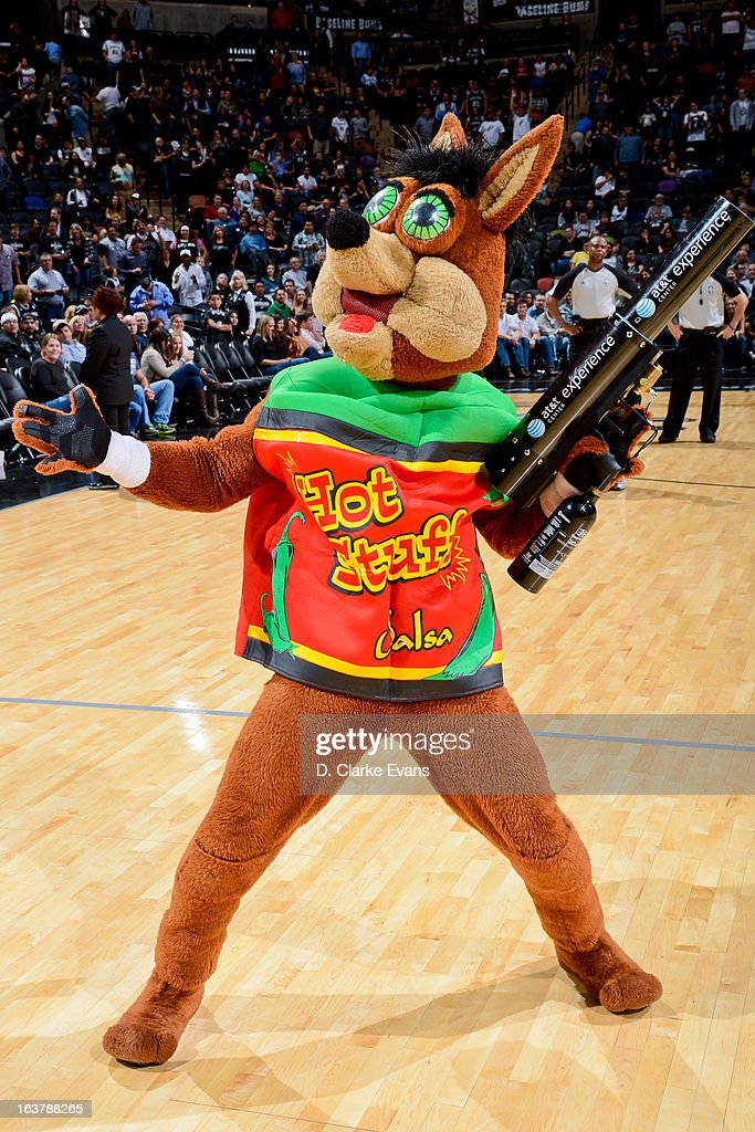 The Coyote, mascot of the San Antonio Spurs, shoots T-shirts to fans during a game against the Detroit Pistons on March 3, 2013 at the AT&T Center in San Antonio, Texas.