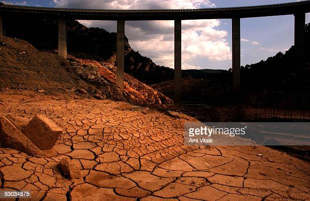 The cracked bed of the tributary of Llosa del Cavall about 150 kilometers northwest of Barcelona normally rushing with water is about three quarters...