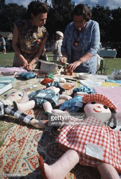 The craft stall including several dolls at the church fete in the Rectory garden at Pembridge in England circa June 1966 During the summer of 1966...