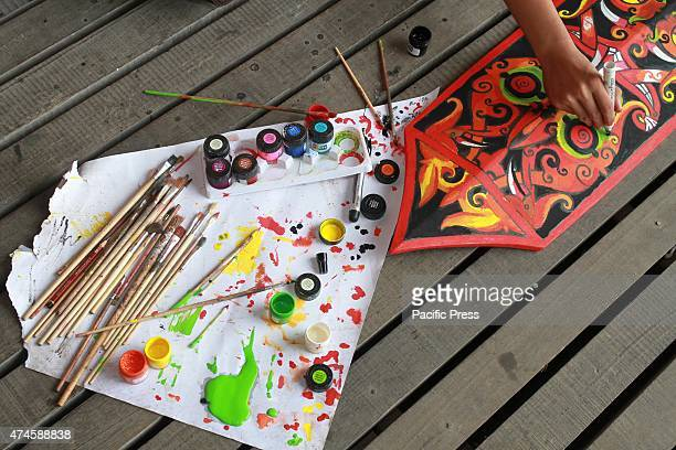 The craftsman of Dayak competing to curve and paint shields using real wood material of Borneo's best quality called Belian during the Gawai Dayak...