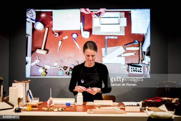 The craftswoman Claire Premesnil works during 'Time Capsule' by Louis Vuitton Exhibition on April 16 2018 in Madrid Spain