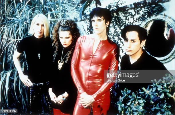 The Cramps Slim Chance in black Poison Ivy Rorschach in black with red boots Lux Interior in red latex catsuit and Harry Drumdini in black in lush...