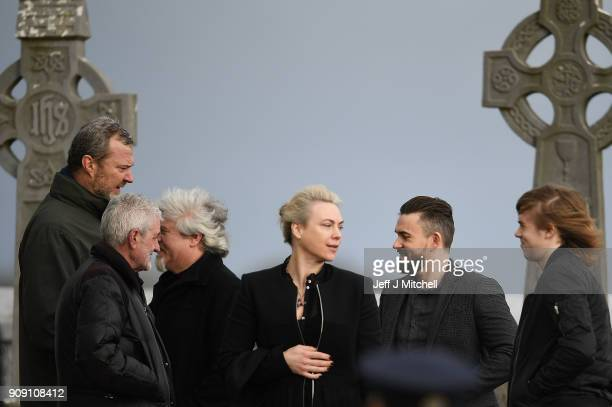 The Cranberries band member Mike Hogan and his wife Siobhan stand outside St Ailbe's parish church in Ballybricken ahead of Dolores O'Riordan's...