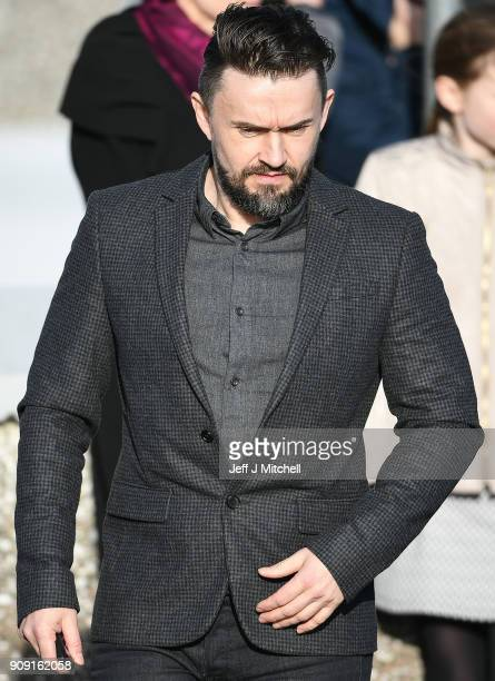 The Cranberries band member Mike Hogan stands outside St Ailbe's parish church in Ballybricken after Dolores O'Riordan's funeral on January 23 2018...