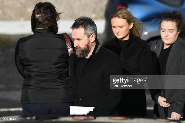 The Cranberries band member Noel Hogan stands outside St Ailbe's parish church in Ballybricken after the funeral on January 23 2018 in Limerick...