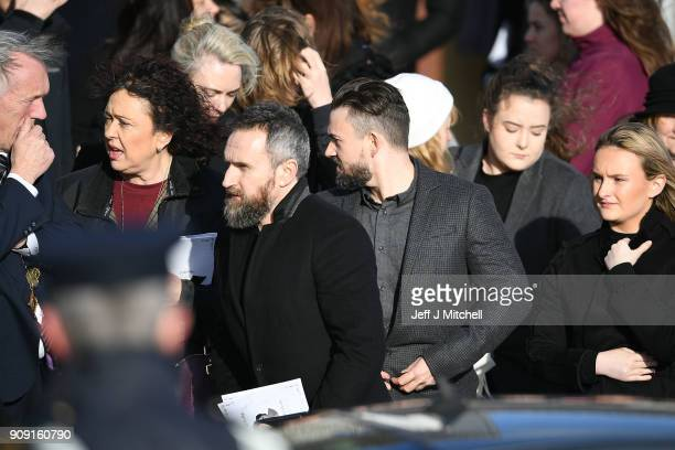 The Cranberries band members Mike Hogan and Noel Hogan stand outside St Ailbe's parish church in Ballybricken after Dolores O'Riordan's funeral on...