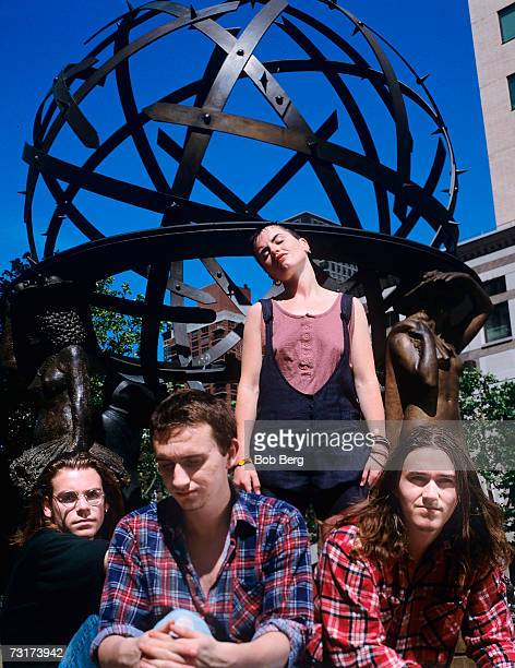 The Cranberries bassist Michael Hogan lead singer Dolores O'Riordan drummer Fergal Lawler and guitarist Noel Hogan poses for a 1995 portrait in front...