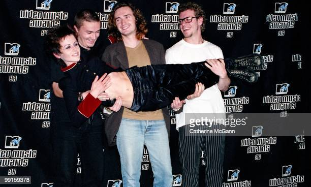 The Cranberries hold singer Dolores O'Riordan and pose for a group photo at the 13th Annual MTV Video Music Awards on September 4, 1996 at Radio City...