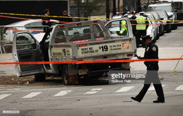 The crashed vehicle used in what is being described as a terrorist attack sits in lower Manhattan the morning after the event on November 1 2017 in...