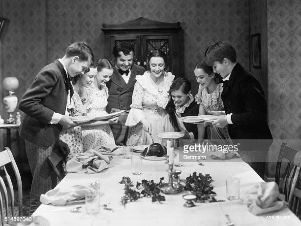The Cratchit family at Christmas dinner in a scene from 'A Christmas Carol', directed by Edwin L. Marin, 1938. From third left, June Lockhart, Gene...