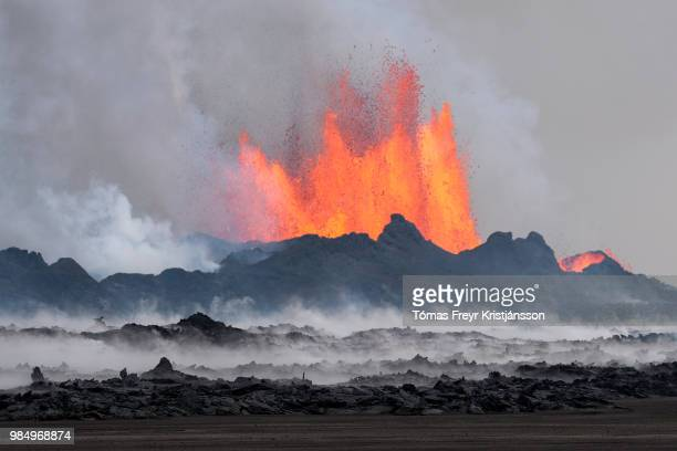 the crater baugur - erupting stock pictures, royalty-free photos & images
