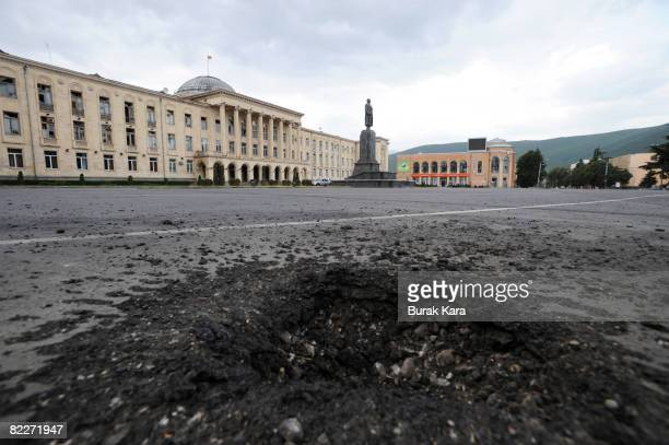 The crater from a Russian shell blast in Stalin square on August 12 2008 in Gori Georgia Russian President Dmitry Medvedev has ordered an end to the...