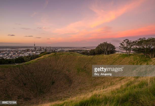 The crater of Mount Eden an iconic volcano in Auckland, New Zealand at dusk.
