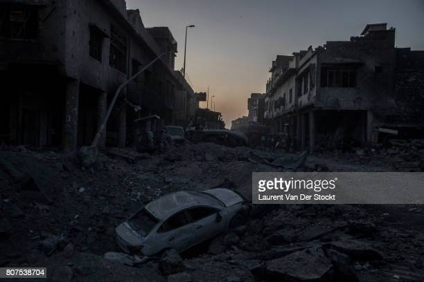 The cratered roadway of Farouk street at night in the Old City of Mosul near Al Nuri mosque The Iraqi Army Special Operations Forces and...
