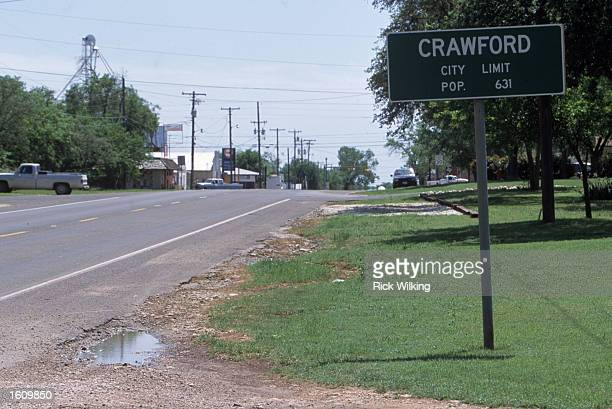 The Crawford City Limits sign is posted along a road April 11 2001 in Crawford TX The President George W Bush family home 'Prairie Chapel Ranch' is...