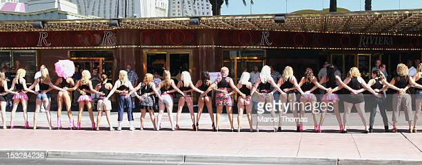 The Crazy Girls Topless Revue join members of the public in a reenactment of their iconic pose to celebrate their 25th Anniversary at the Riviera...