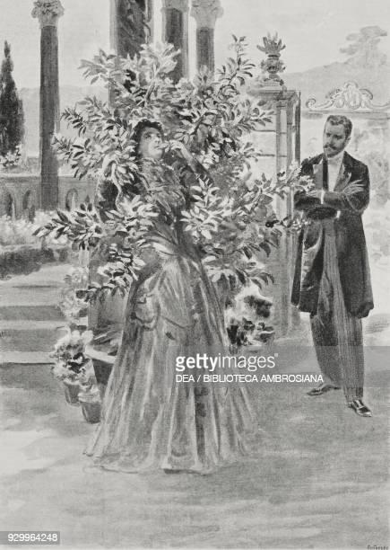 The crazy woman kissing leaves Eleonora Duse in the drama Sogno di un mattino di primavera by Gabriele D'Annunzio at the Theater de la Renaissance in...