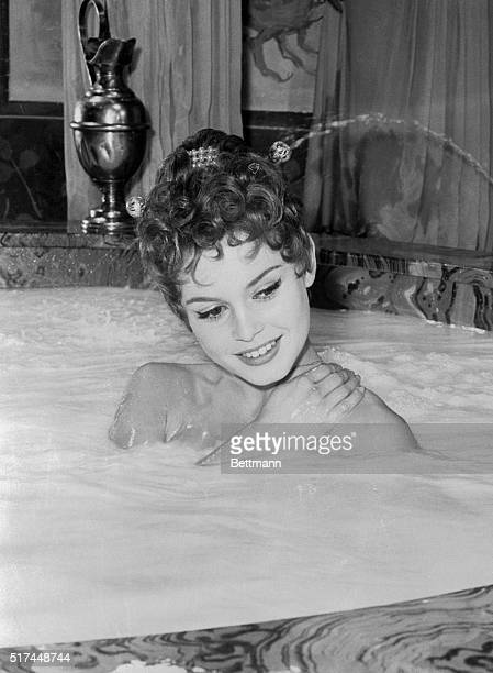 The cream on top of this bathtub of milk is pretty French actress Brigitte Bardot. In a movie being made in Rome, she plays Nero's beautiful wife,...
