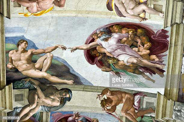 The Creation of Adam by Michelangelo is painted on the ceiling of the Sistine Chapel in the Vatican Museums on August 4 in Rome Italy The Creation of...