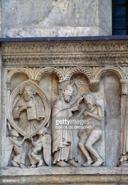 The creation of man detail from Stories of Genesis by Wiligelmus marble basrelief facade of the Metropolitan Cathedral of Saint Mary of the...