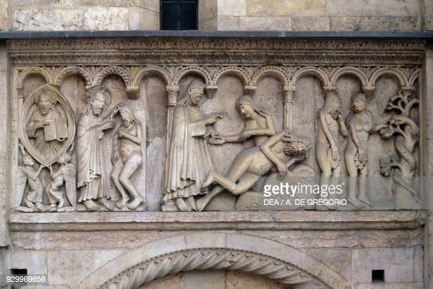The creation of man woman and the Original sin detail from Stories of Genesis by Wiligelmus marble basrelief facade of the Metropolitan Cathedral of...
