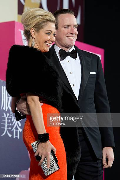 The creative director of Swarovski Nadja Swarovski and her husband Rupert Adams pose for photographers as they arrive for an event celebrating the...