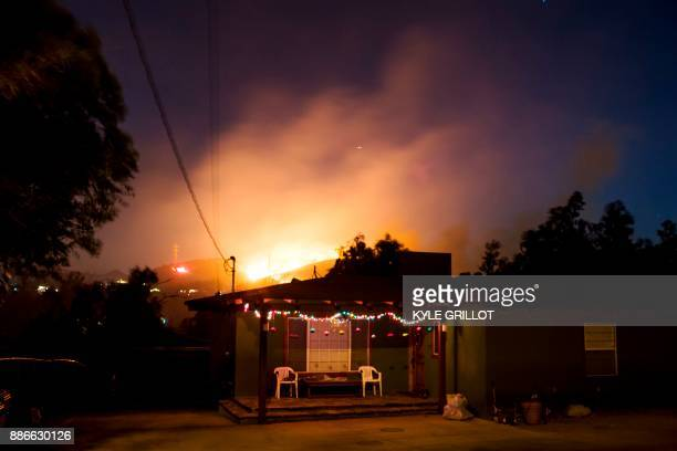 The Creek Fire burns along a hillside near homes in the Shadow Hills neighborhood of Los Angeles California December 5 2017 More than a thousand...
