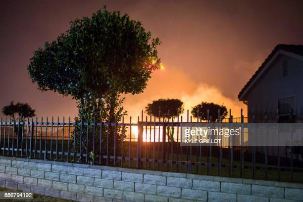 The Creek Fire burns along a hillside near homes in the Shadow Hills neighborhood of Los Angeles California on December 5 2017 More than a thousand...