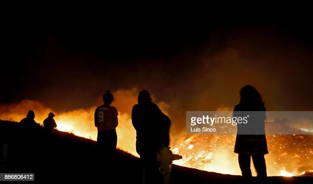 The Creek Fire burns into the night in the Shadow Hills neighborhood of Sylmar on December 5 2017 in Ventura County California The fire started at...