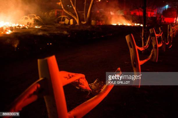 The Creek Fire burns property outside homes in the Shadow Hills neighborhood of Los Angeles California December 5 2017 More than a thousand...