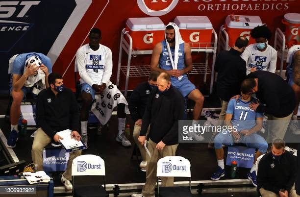 The Creighton Bluejays bench reacts to the loss in the final minutes of the game against the Georgetown Hoyas during the Big East Championship game...