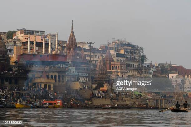 The Cremation Ghats seen In Varanasi. Varanasi is a city in India which lies on the banks of the Ganges River. It draws Hindu pilgrims from all parts...