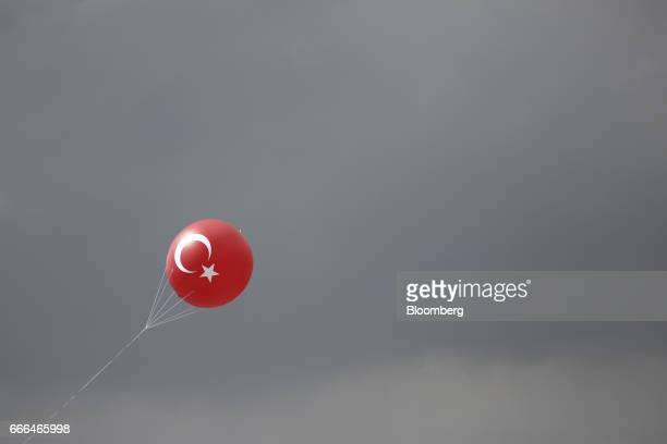 The crescent and star symbol of the Turkish national flag sits on a balloon as it flies during a 'Yes' referendum campaign rally in Yenikapi square...