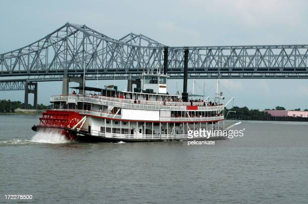 The Crescent City Connection pictured alongside a boat