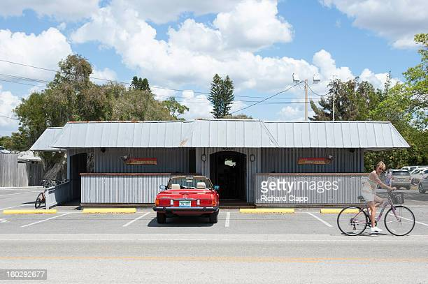 CONTENT] The Crescent Club is a popular local pub in the beach town of Siesta Key in Sarasota FL A red convertable is parked in front of the pub and...