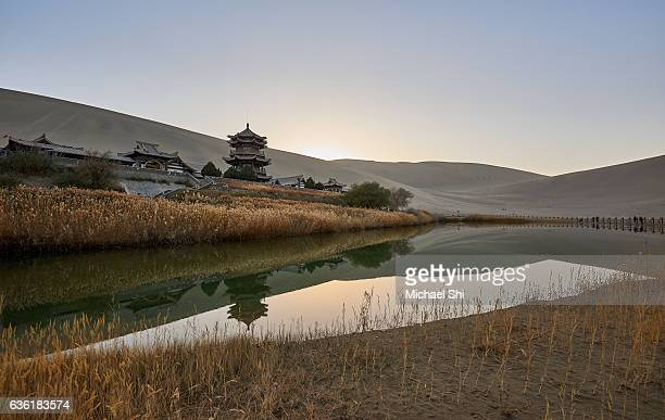 The Crescent Lake of Dunhuang, Yuanyaquan, with the temple and its reflections in the water in the middle of the desert.