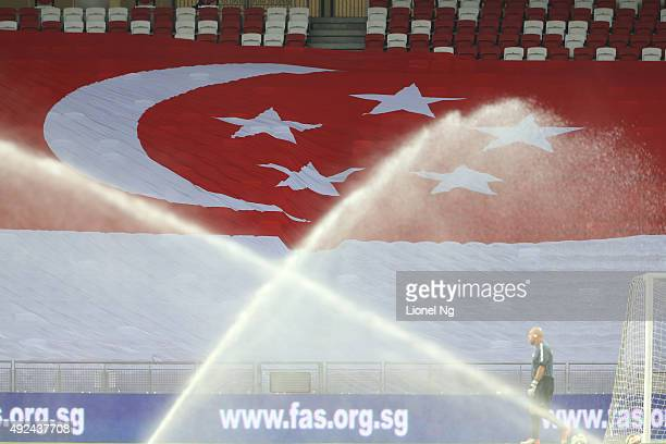 The crescent moon and five stars of the Singapore flag are seen before the FIFA 2018 World Cup Qualifier match between Singapore and Cambodia at the...