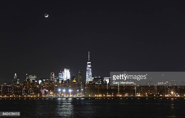 The crescent moon sets above lower Manhattan on January 30, 2017 in New York City.