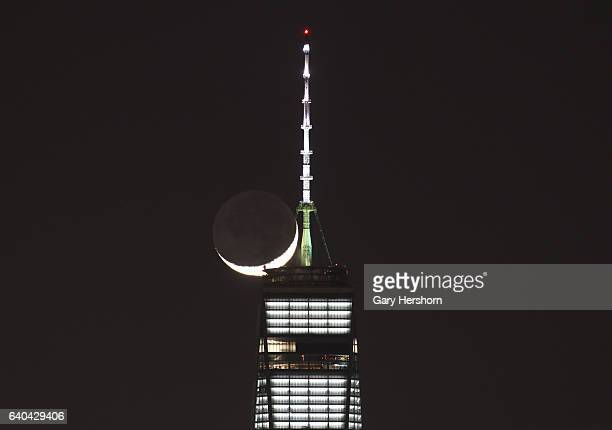The crescent moon sets behind One World Trade Center in lower Manhattan on January 30, 2017 in New York City.