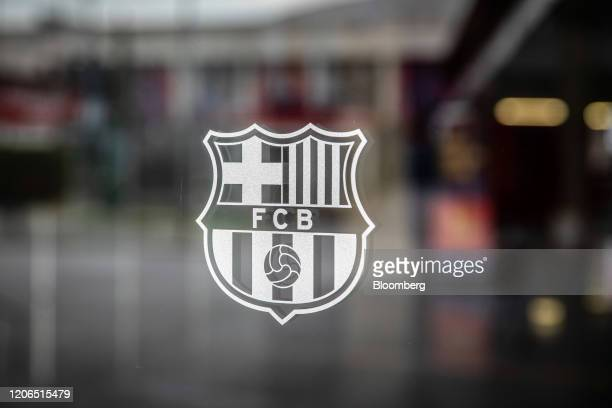 The crest for FC Barcelona sits on a window at the Camp Nou stadium stands in Barcelona Spain on Tuesday March 10 2020 Spains economy is particularly...