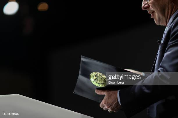 The crest of the Federal Reserve Bank of New York sits on a folder held by William Dudley president and chief executive officer of the Federal...