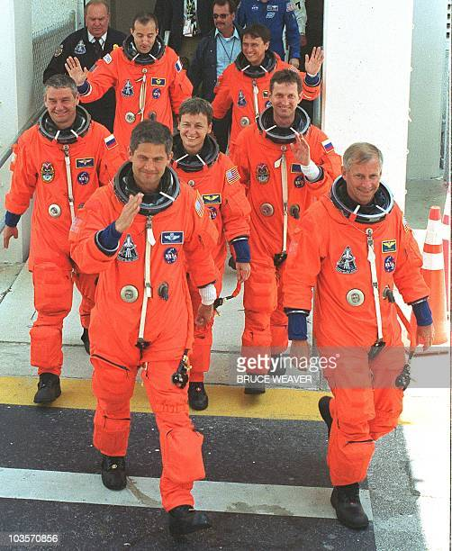 The crew and International Space Station Expedition 5 passengers of the US space shuttle Endeavour Pilot US Paul Lockhart Commander US Ken Cockrell...