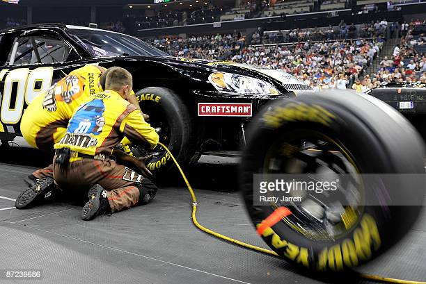 The crew competes during the NASCAR Sprint Pit Crew Challenge on May 14 2009 at Time Warner Cable Arena in Charlotte North Carolina