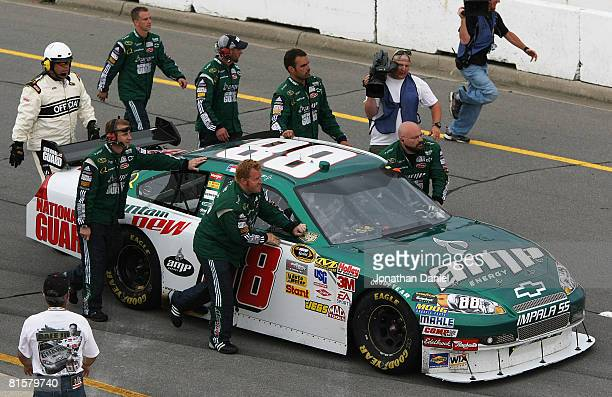 The crew for Dale Earnhardt Jr push his National Guard/AMP Energy Chevrolet to victory lane after the NASCAR Sprint Cup Series Lifelock 400 at the...