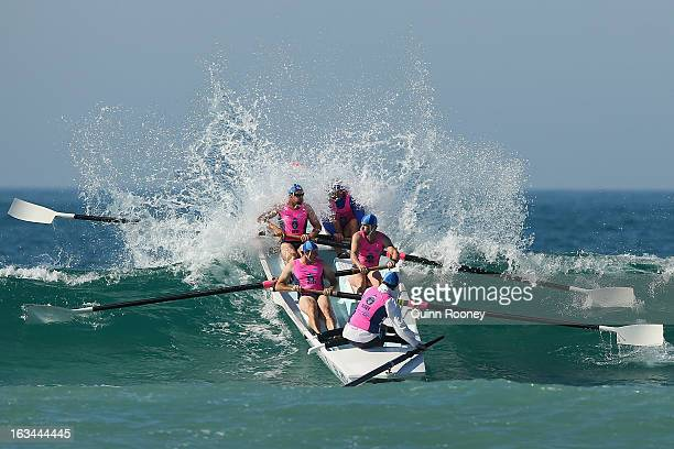 The crew from St Kilda crash through a wave in the surf boat race during the Victorian Surf Lifesaving Championships on March 10 2013 in Anglesea...