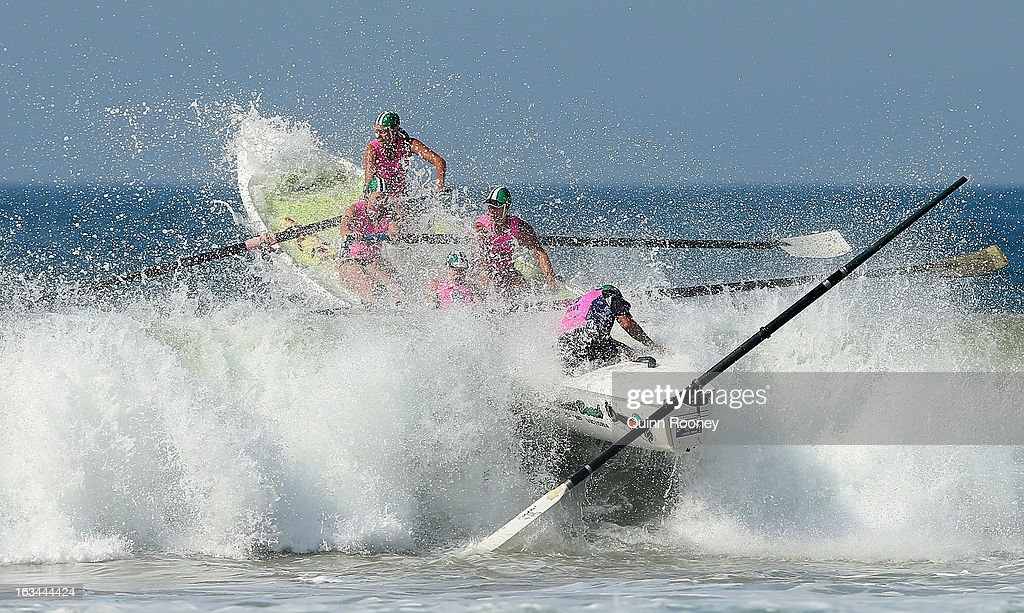 The crew from Woolamai Beach crash through a wave in the surf boat race during the Victorian Surf Lifesaving Championships on March 10, 2013 in Anglesea, Australia.