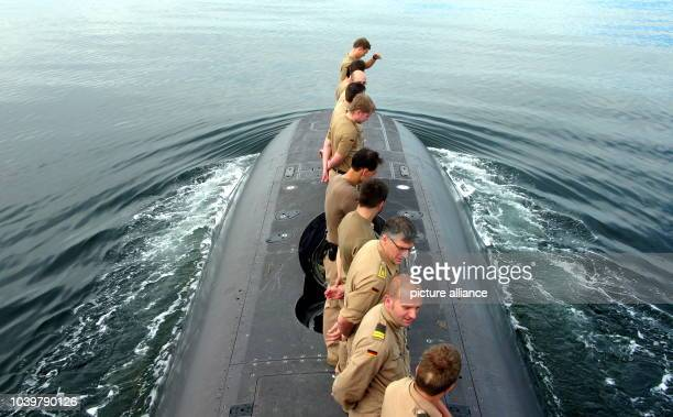 The crew members of the German submarine 'U 32' stand on deck shortly before the return to the Baltic Sea naval base in Eckernfoerde Germany 19...