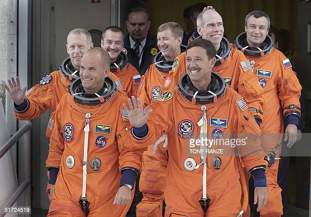 The crew members of the space shuttle Discovery Pilot Frederick Sturckow Commander Scott Horowitz Mission Specialist Patrick Forrester Mission...